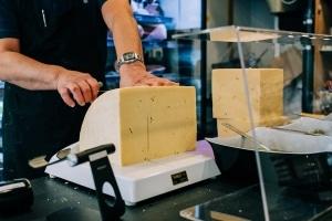 branding-chandos-deli-cheese-cutting