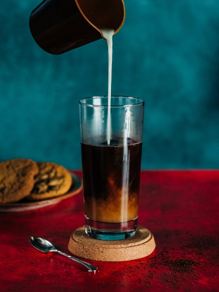 Milk Pour into Coffee Glass