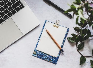 Desk and notepad flatlay