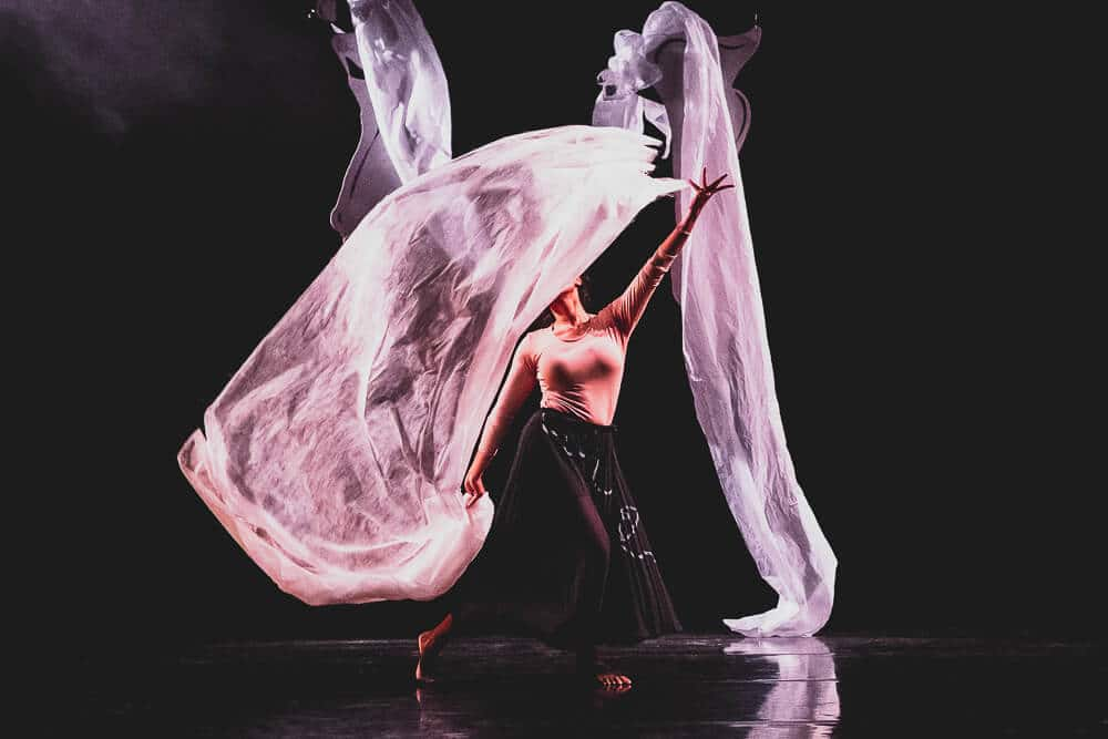 Dancer waves cloth overhead during London performance